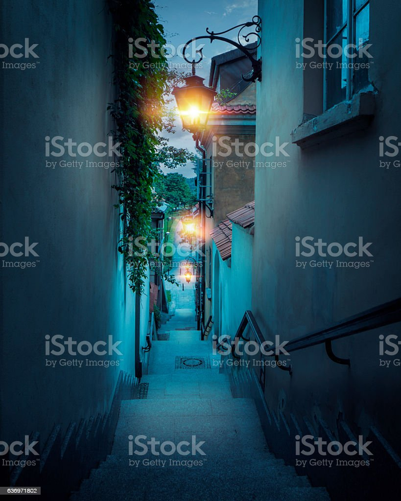 Romantic street of the old town in Warsaw at night stock photo