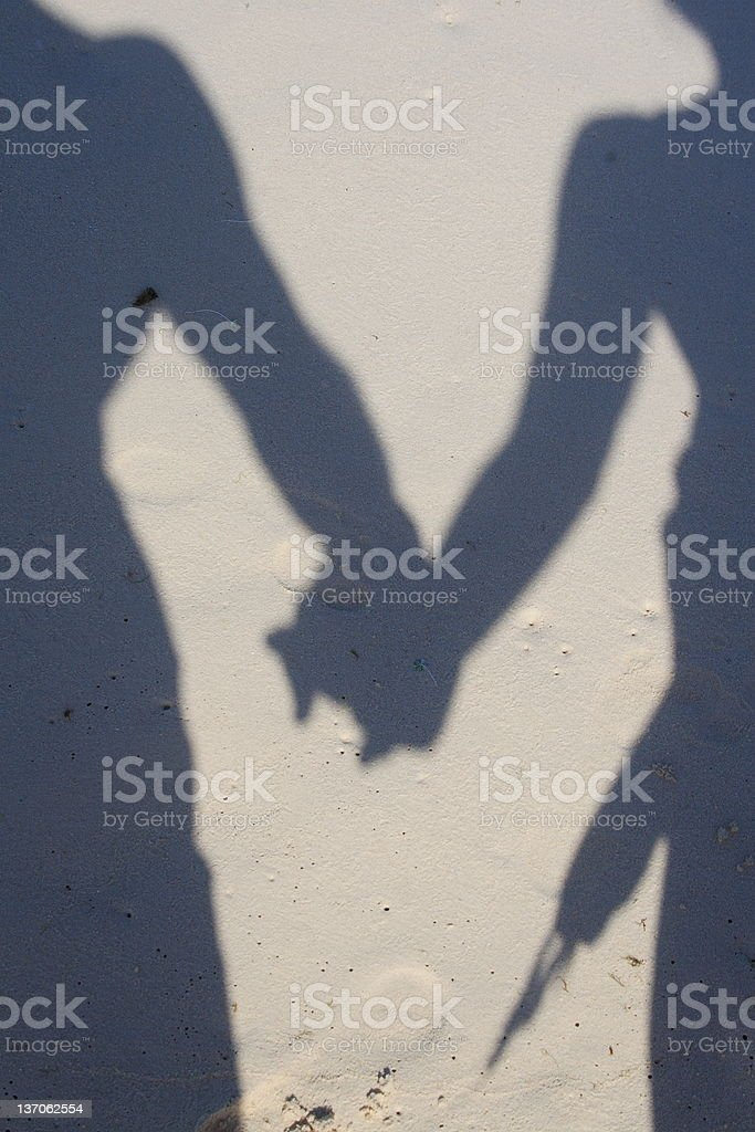 Romantic stroll on the beach royalty-free stock photo