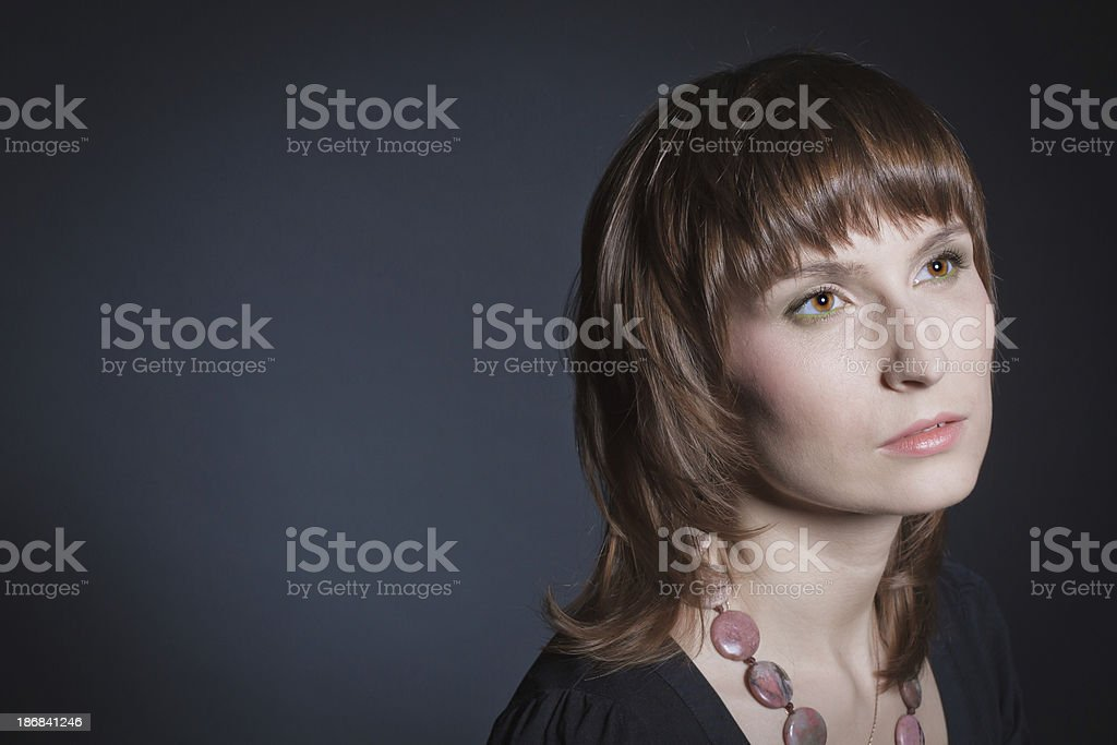 Romantic style portrait of a beautiful woman against black background stock photo