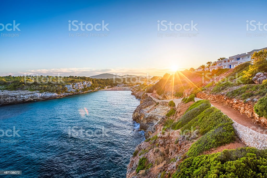 Romantic sunset on Cala Romantica - Majorca stock photo