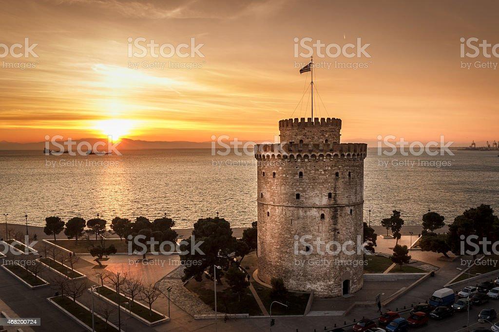 Romantic sunset watching the White Tower of Thessaloniki stock photo