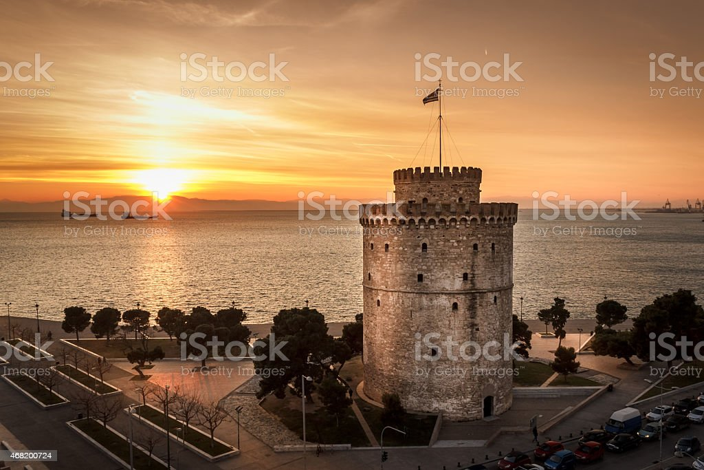 Romantic sunset watching the White Tower of Thessaloniki stock photo