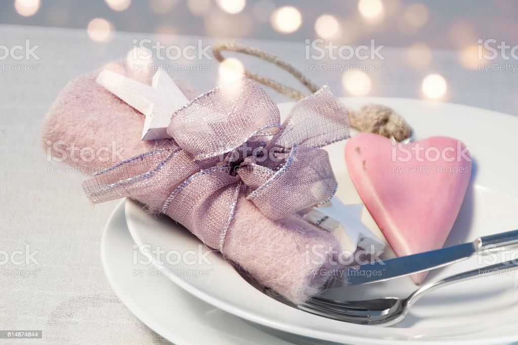 Romantic table decoration for a Christmas dinner stock photo