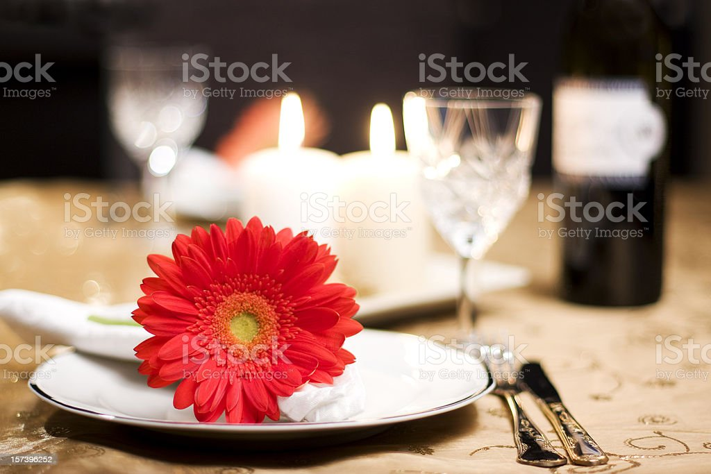 A romantic table for two with a red flower royalty-free stock photo