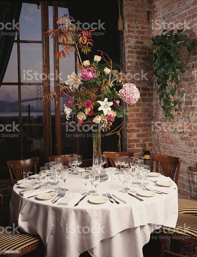 romantic table with bridge in background royalty-free stock photo