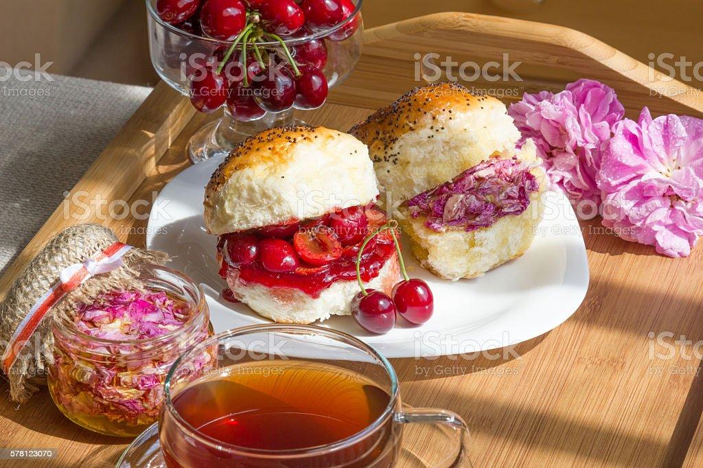 Romantic tea with cherry scones stock photo