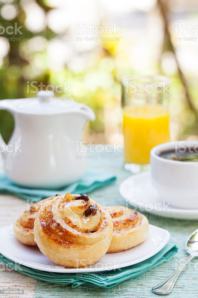 Romantic tropical breakfast Danish pastry, coffee, juice. Summer background stock photo