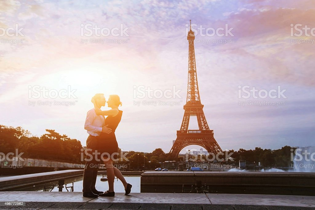 romantic vacations in Europe, silhouettes of loving couple in Paris stock photo