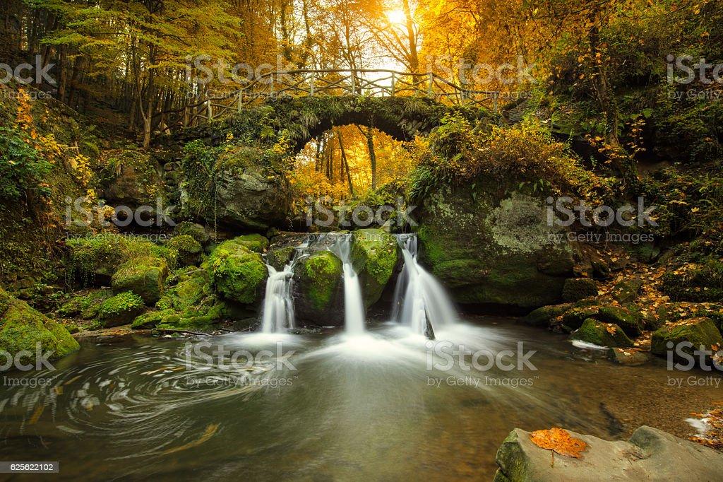 romantic waterfall in Luxemburg stock photo
