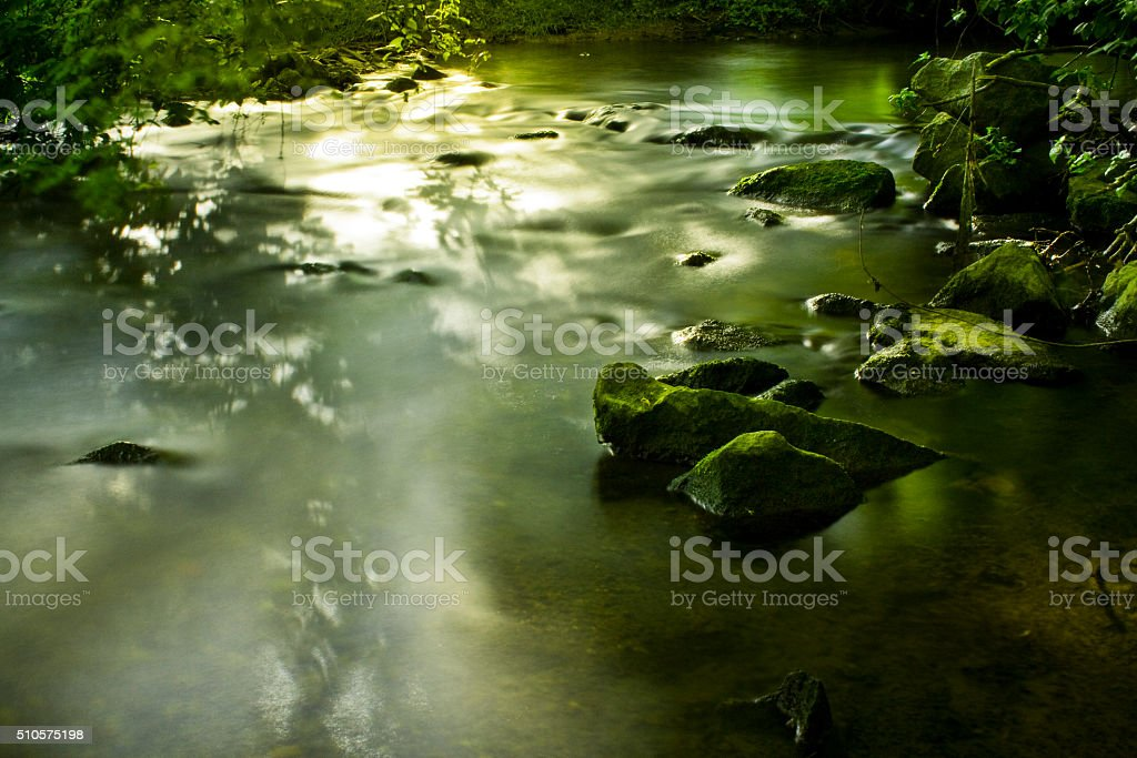 romantic waterfall on stone terraces with green moss stock photo