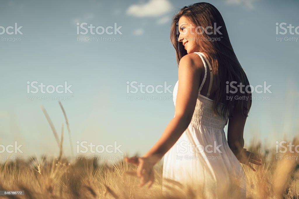 Romantic woman in fields of barley stock photo