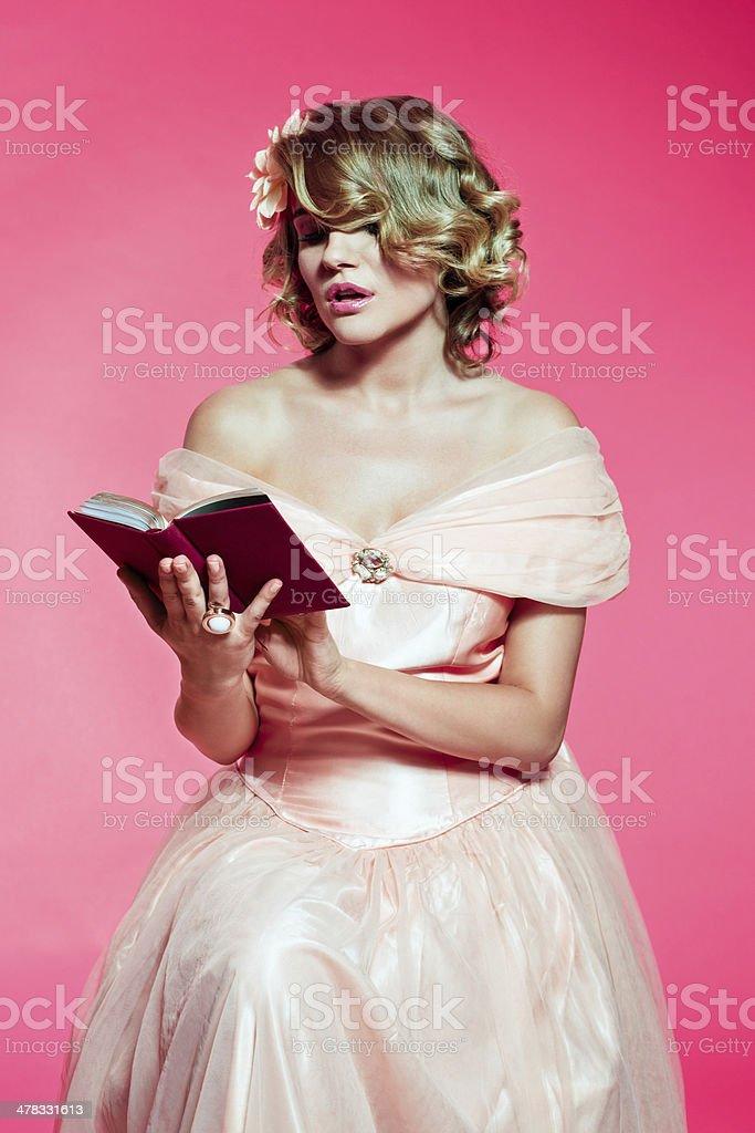 Romantic woman reading book royalty-free stock photo