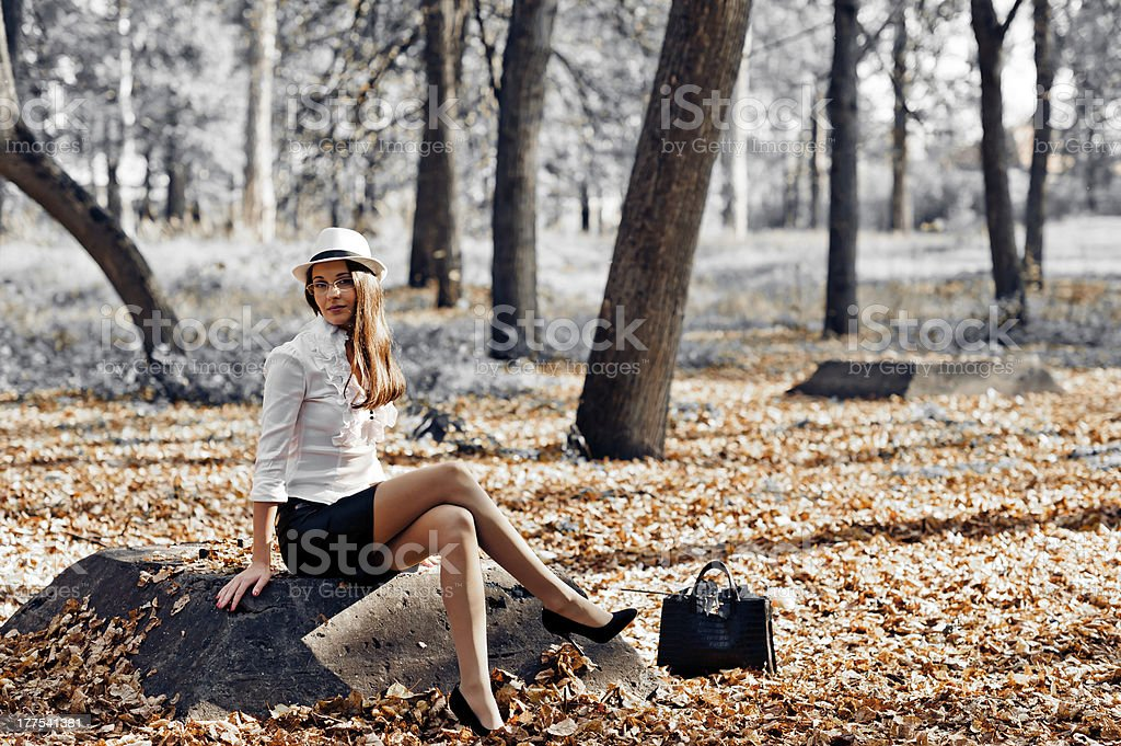 romantic woman sitting on a rock royalty-free stock photo