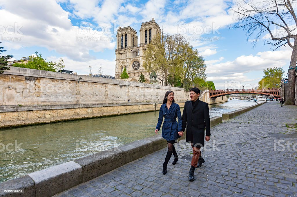 Romantic Young Asian Couple in Love on Vacation in Paris stock photo
