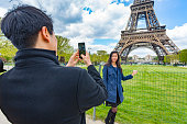 Romantic Young Asian Couple Taking Vacation Portraits in Paris