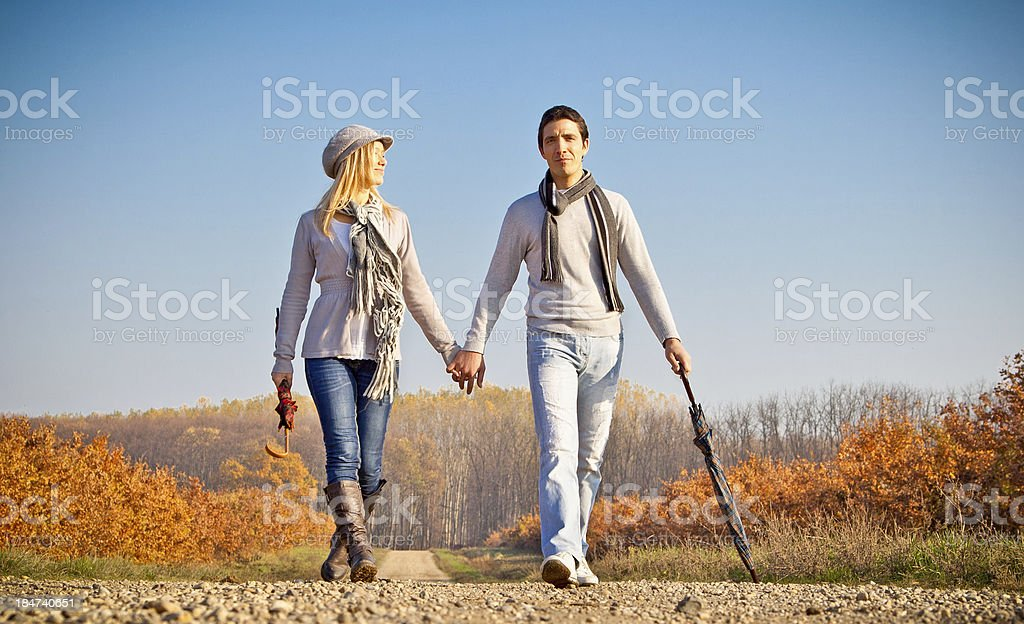 Romantic young beautiful couple on autumn walk. royalty-free stock photo