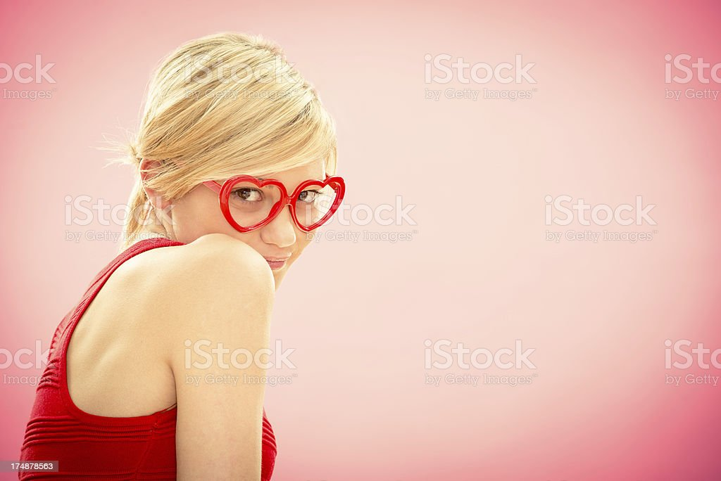 Romantic young beautiful girl in love pink background royalty-free stock photo