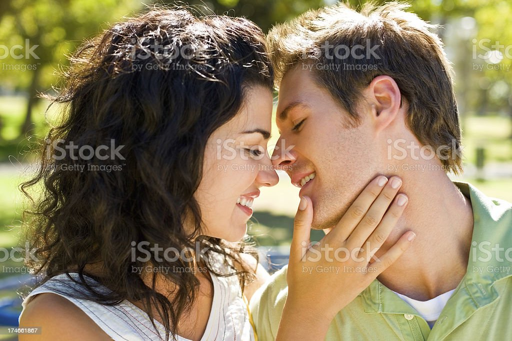 Romantic young couple at park in love royalty-free stock photo