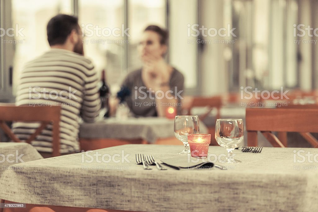 Romantic Young Couple at Restaurant stock photo