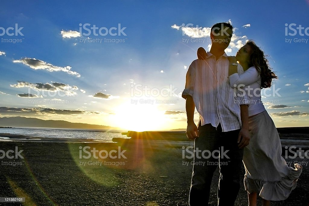 Romantic Young Couple at Sunset stock photo