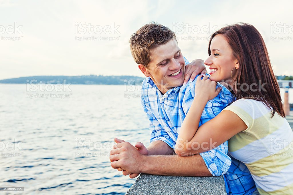 Romantic Young Couple Enjoying a Moment Alone on Seattle Pier stock photo