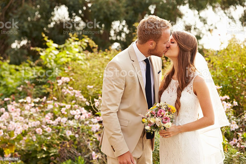 Romantic Young Couple Getting Married Outdoors stock photo