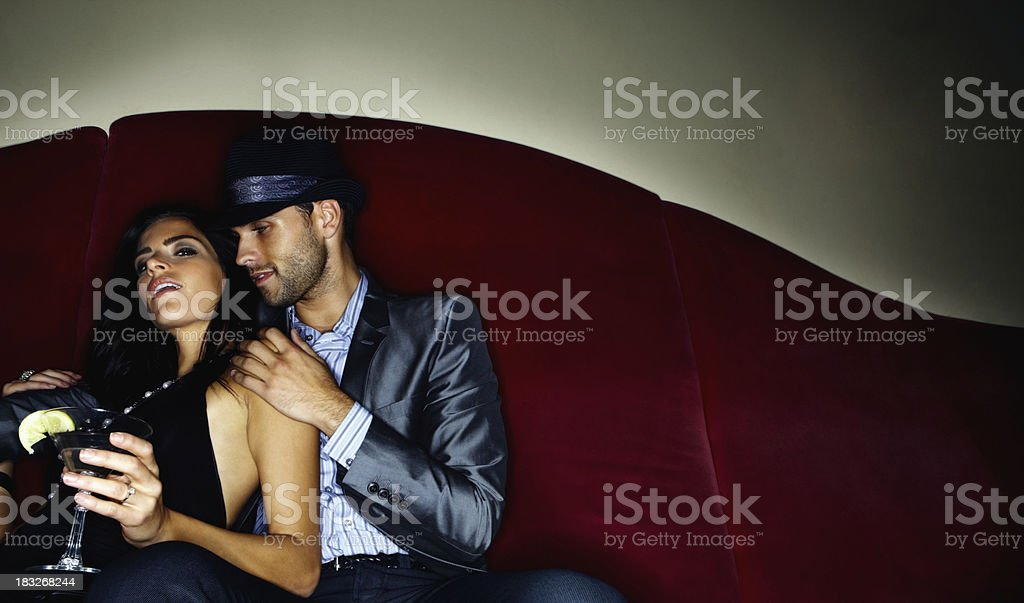 Romantic young couple in a cocktail party royalty-free stock photo