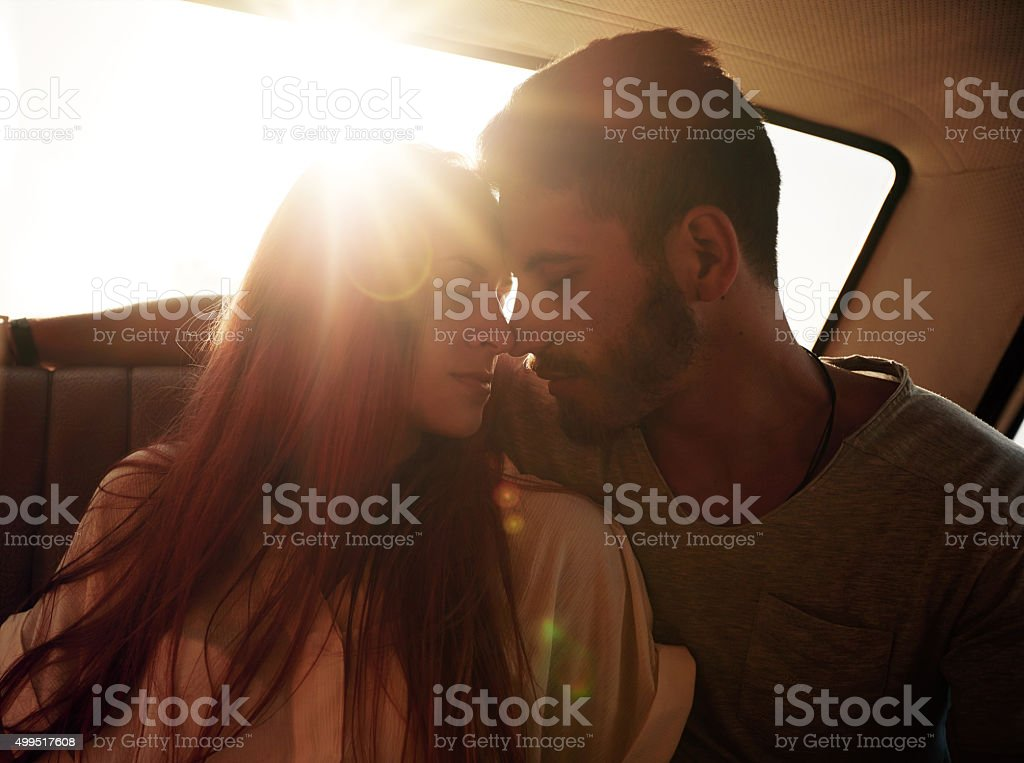 Romantic young couple in car stock photo