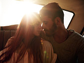 Romantic young couple in car