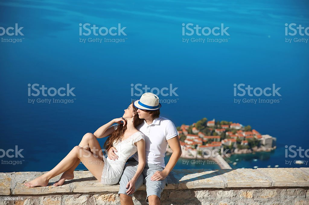 Romantic young couple in love over sea, above Sveti Stefan stock photo