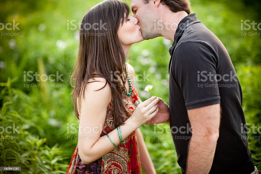 Romantic Young Couple Kissing Each Other Outside royalty-free stock photo