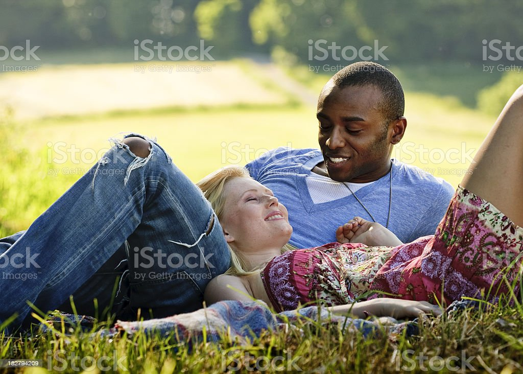 Romantic Young Couple Lying in the Grass royalty-free stock photo
