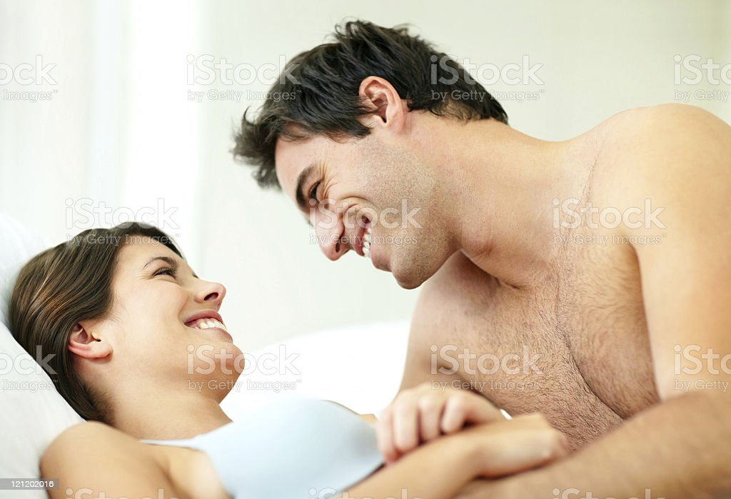 Romantic young couple relaxing on the bed royalty-free stock photo