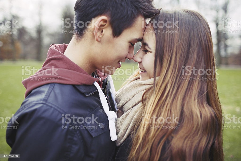 Romantic young couple sharing a special moment outdoors stock photo