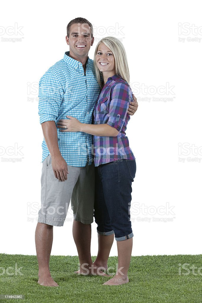 Romantic young couple standing on grass royalty-free stock photo