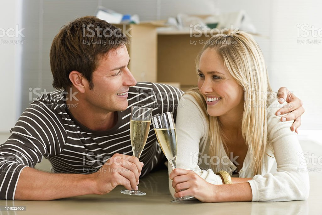 Romantic young couple toasting champagne glass royalty-free stock photo