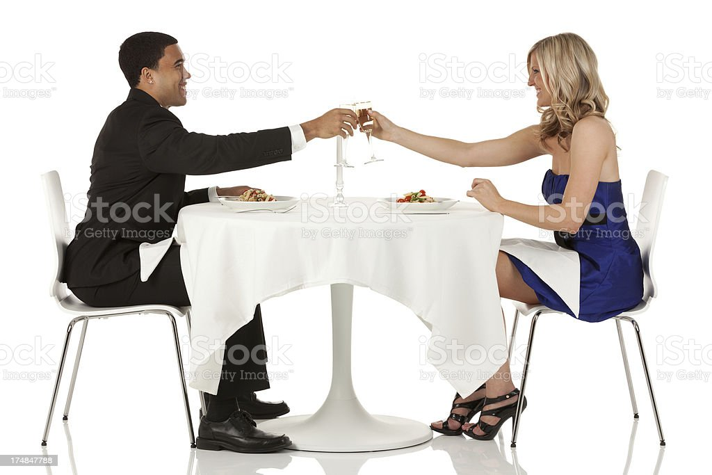 Romantic young couple toasting with champagnes flutes royalty-free stock photo