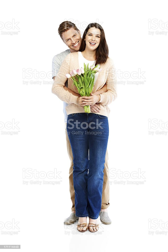 Romantic young couple with a flower bouquet royalty-free stock photo