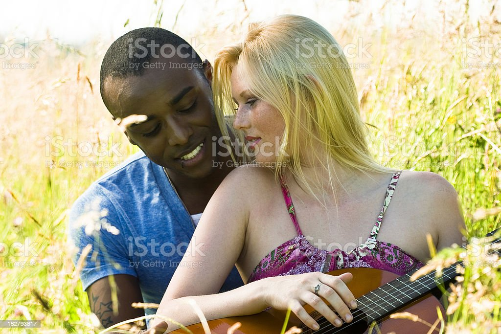 Romantic Young Couple With a Guitar royalty-free stock photo