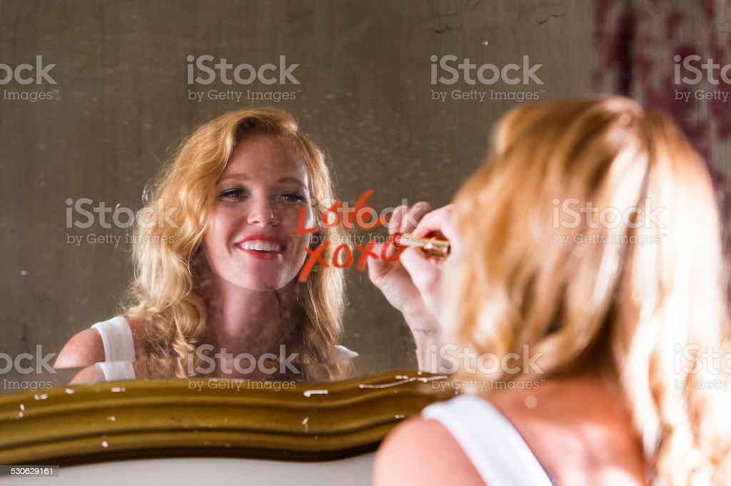 Romantic young woman in love stock photo