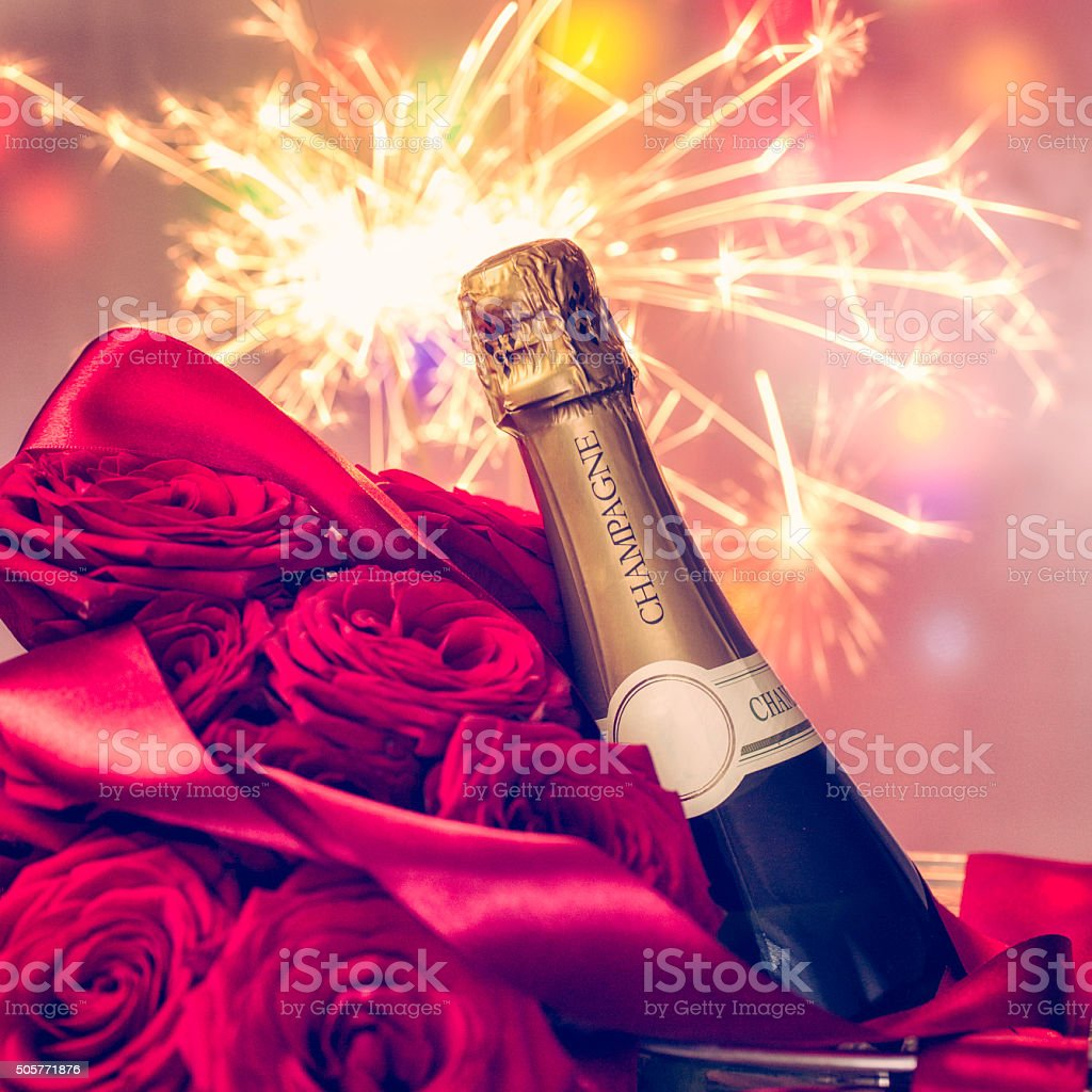 Romatic Bouquet of Red Roses and a Bottle of Champagne stock photo