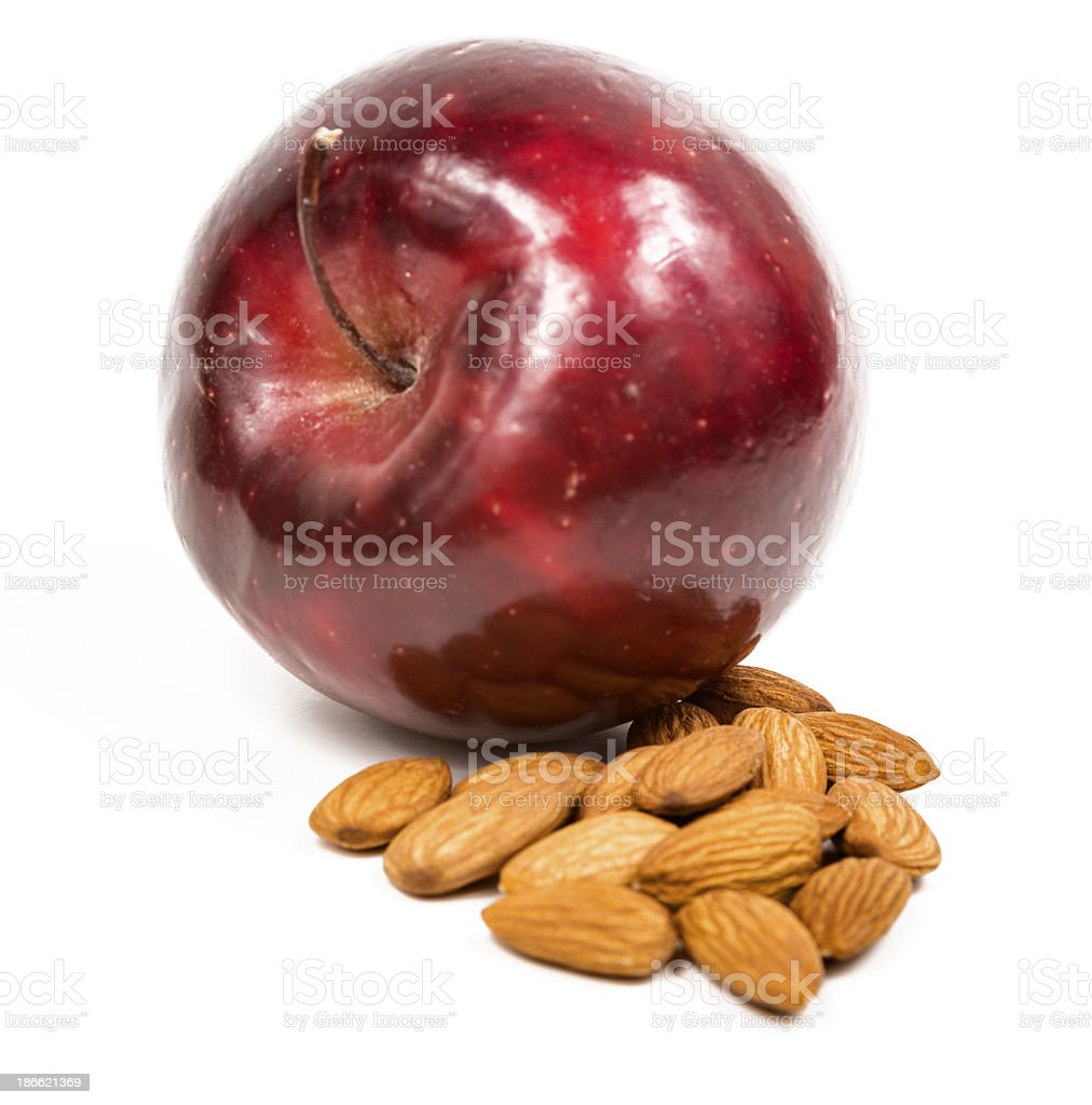 Rome apple and almonds on white royalty-free stock photo