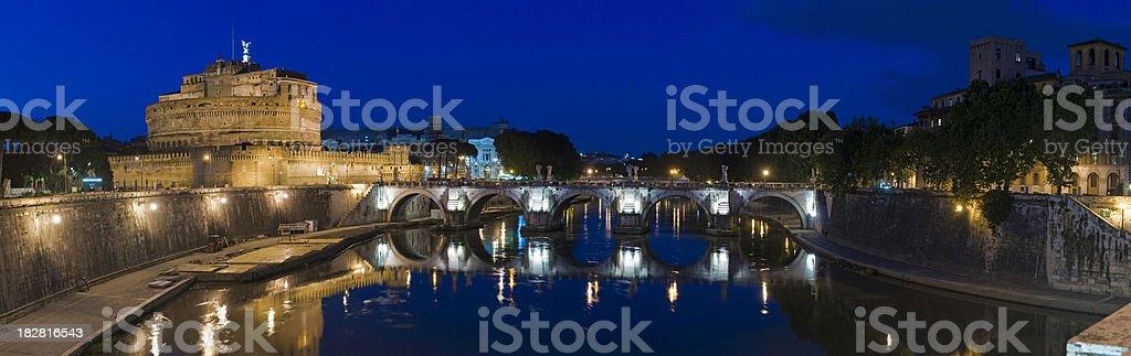Rome Castel Ponte Sant'Angelo illuminated summer dusk Tiber panorama Italy stock photo