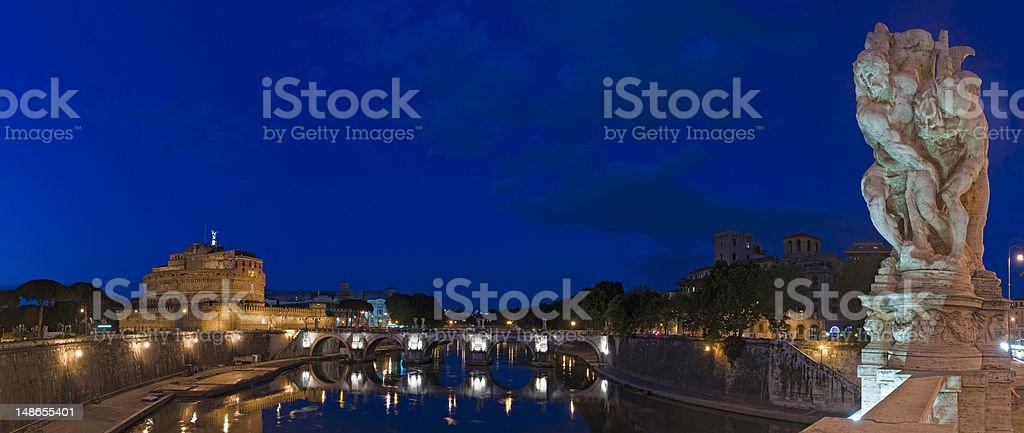 Rome Castel Sant'Angelo River Tiber bridges blue dusk panorama Italy stock photo