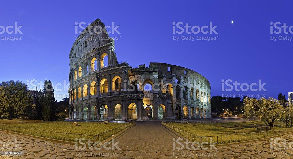 Rome Coliseum ancient Roman amphitheatre illuminated piazza panorama Italy stock photo