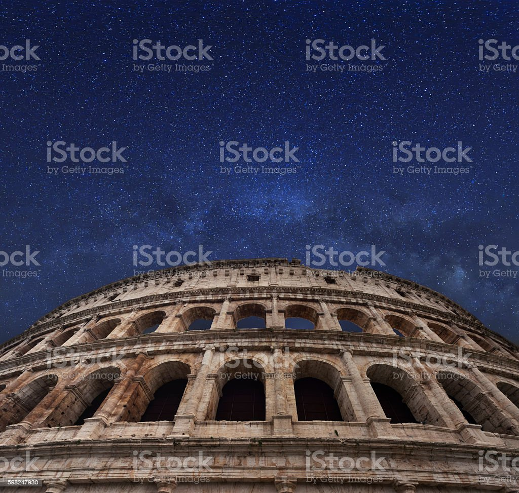 Rome coliseum and milky way in the midnight sky stock photo