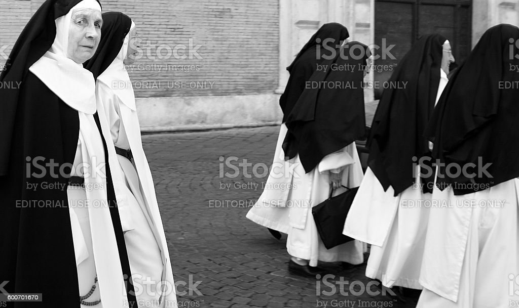 Rome, Italy: Group of Nuns in Traditional Habit (B&W) stock photo