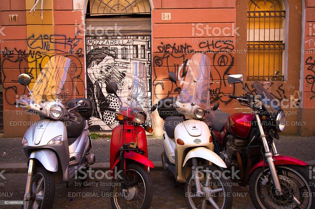 Rome, Italy: Motorbikes Parked Near Grotty Graffitti Wall stock photo