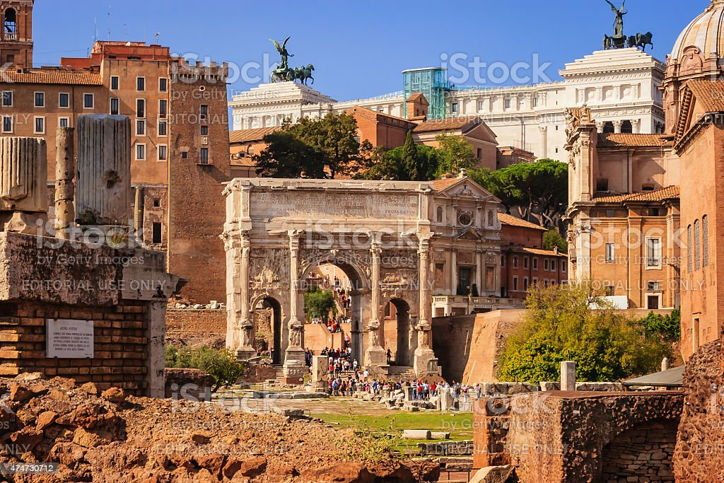 Rome, Italy: Tourists stream through the Arch of Septimius Severus. stock photo