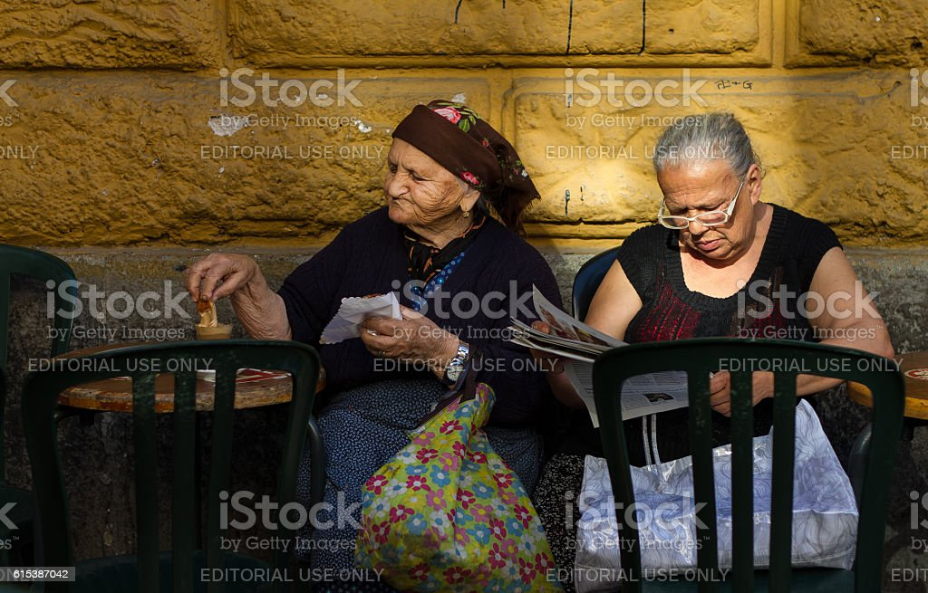 Rome, Italy: Two Senior Women Relax at Outdoor Cafe stock photo